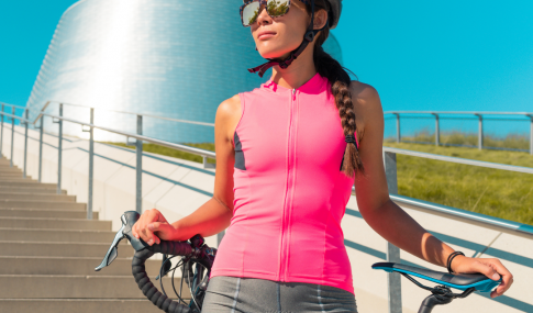 female cyclist with summer equipment